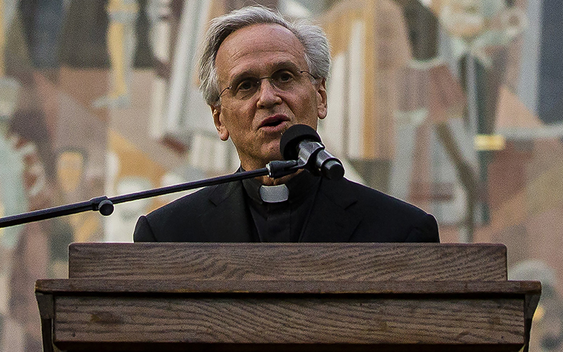 """Holy Cross Father John I. Jenkins, president of the University of Notre Dame in Indiana, addresses the crowd June 1, 2020, during the """"Pray for Unity, Walk for Justice"""" event in memory of George Floyd on the campus near South Bend."""
