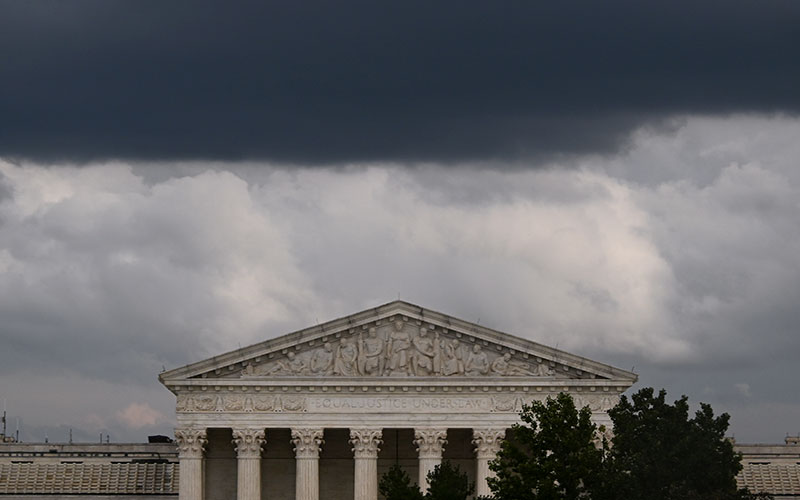 Clouds form over the U.S. Supreme Court in Washington Sept. 29, 2020. The Supreme Court begins hearing cases for the new term Oct. 5.