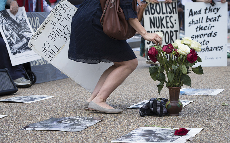 In this 2018 file photo, peace activists hold a Catholic prayer service of repentance near the White House for the use of nuclear weapons on Japan during World War II.