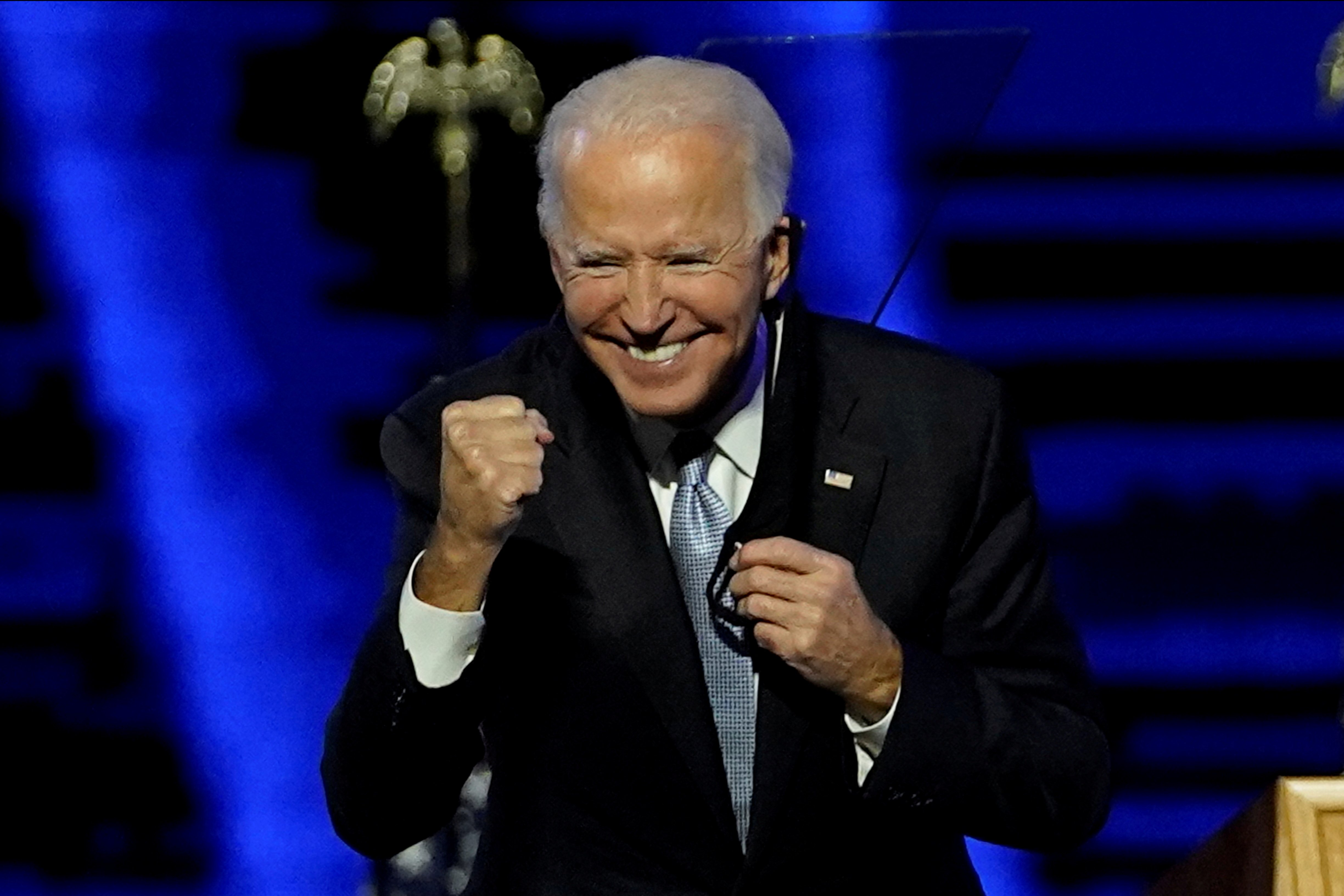 Democratic presidential nominee Joe Biden gestures during his election rally in Wilmington, Del., Nov. 7, 2020, after news media declared he won the presidential election.