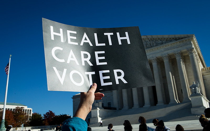 People demonstrate in support of the Affordable Care Act outside the U.S. Supreme Court in Washington Nov. 10, 2020.