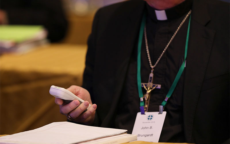 Bishop John B. Brungardt of Dodge City, Kan., votes Nov. 14, 2018, during the fall general assembly of the U.S. Conference of Catholic Bishops in Baltimore.