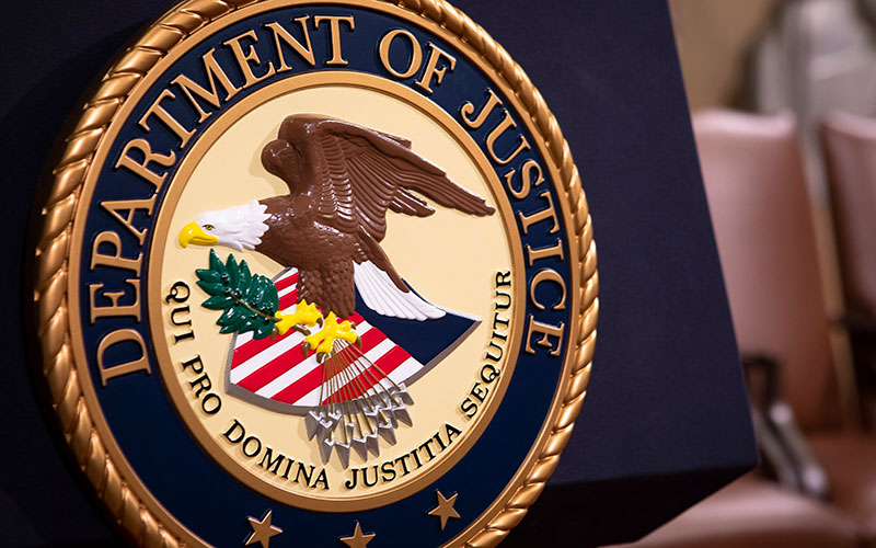 The Department of Justice seal is seen July 30, 2018, in the Great Hall at the Main Justice Building in Washington.