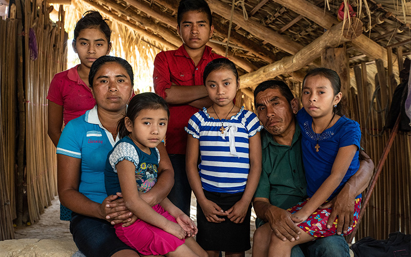 Farmer Silverio Mendez poses with his wife, Irma Mendez, and five of their children Jan. 30, 2019, in Barrio El Cedro, Guatemala.