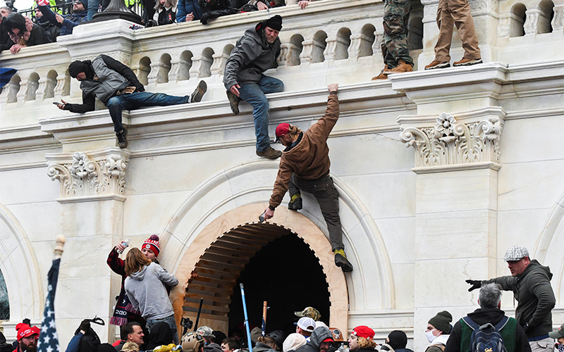 Supporters of President Donald Trump climb on walls at the U.S. Capitol in Washington Jan. 6, 2021, during a protest against Congress certifying the 2020 presidential election.