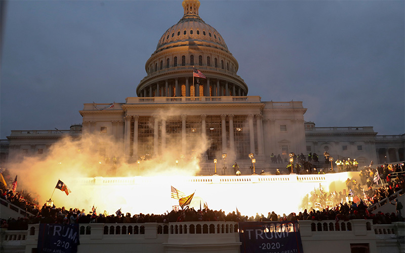 An explosion at the U.S. Capitol in Washington is caused by police munition while supporters of President Donald Trump breach the building Jan. 6, 2021.