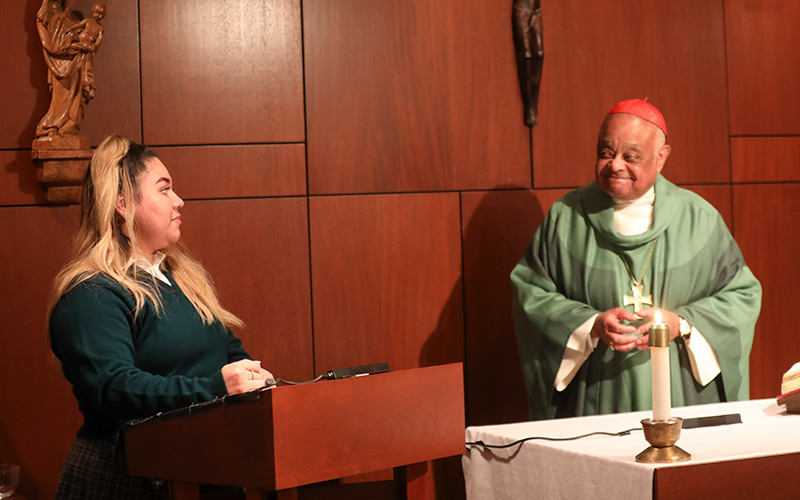 Jennifer Cuadra, a senior at Archbishop Carroll High School in Washington, speaking on behalf of her fellow students during a school Mass Jan. 13, 2021, congratulates Cardinal Wilton D. Gregory on his recent elevation to the College of Cardinals.
