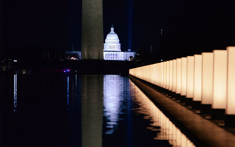 The U.S. Capitol is seen reflected at the reflecting pool at the Lincoln Memorial in Washington Jan. 19, 2021, after President-elect Joe Biden hosted a memorial honoring those who died from the coronavirus disease.