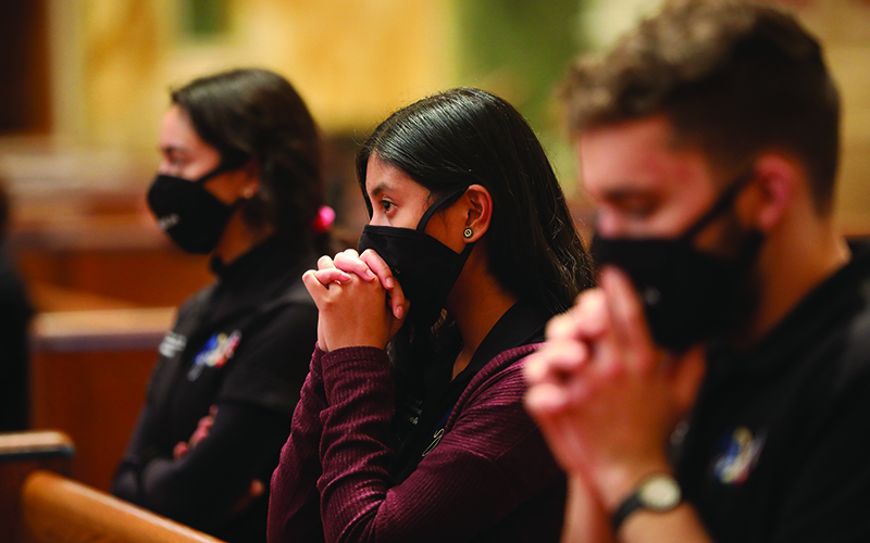 Members of the Archdiocese of Washington Youth Leadership Team pray during a Jan. 29, 2021, Mass for Life at the Cathedral of St. Matthew the Apostle in Washington.