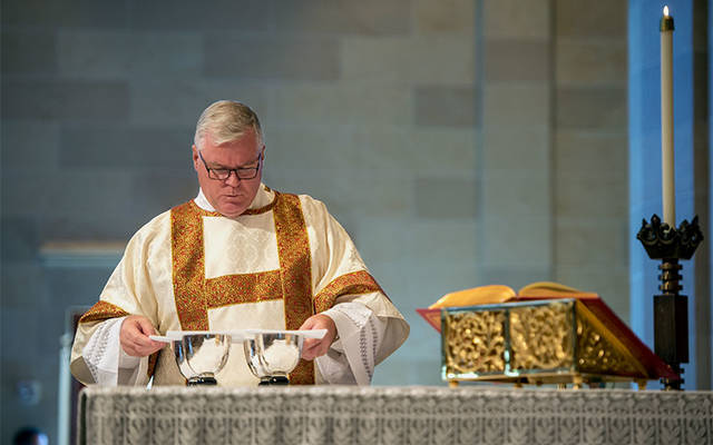 <p>Deacon Edward Giblin prepares the altar during the Diocese of Rochester&rsquo;s sesquicentennial Mass at Sacred Heart Cathedral Sept. 22, 2017. Deacon Giblin is director of the diocese&rsquo;s Office of the Permanent Diaconate. (File photo) </p>