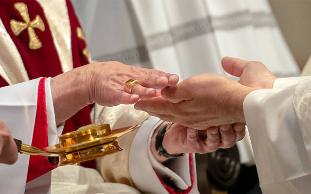 <p>Father Jeff Chichester&rsquo;s hands are anointed by Bishop Salvatore R. Matano during the new priest's ordination Mass June 2 at Sacred Heart Cathedral. (Courier photo by Jeff Witherow) </p>
