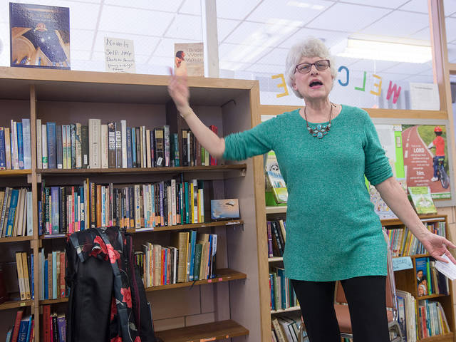 <p>Carolyn Simolo talks about the new library at St. Francis and St. Clare Parish&rsquo;s Ministry Center in Waterloo April 22.(Courier photo by John Haeger) </p>