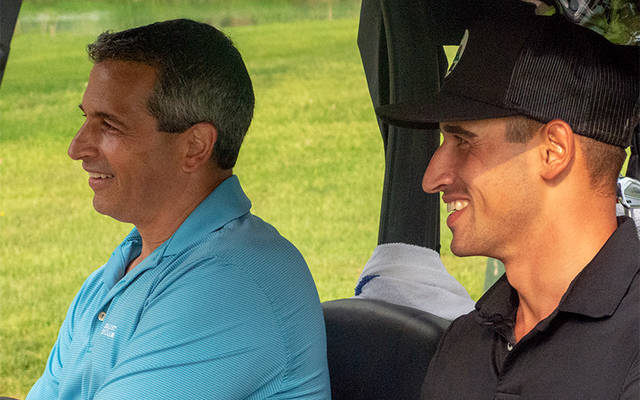 <p>Dominic Bozzelli (right) shares a light moment with his father, Dom, while playing at Locust Hill Country Club May 28. (Courier photo by Mike Latona) </p>