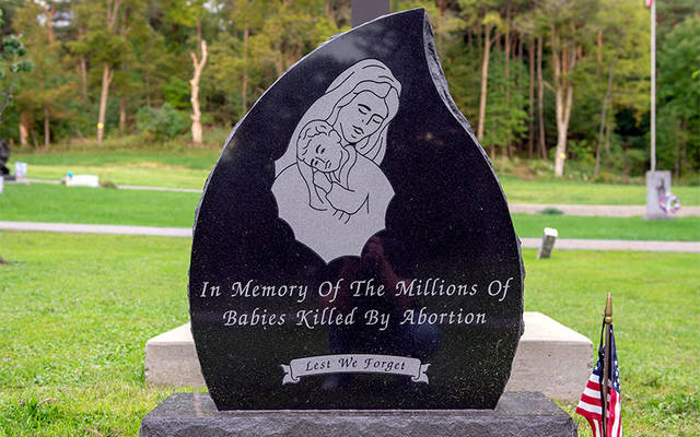 <p>A memorial recalling the unborn — made possible by the Knights of Columbus and other pro-life advocates — was dedicated at Holy Cross Cemetery in Dansville in 2016. (Courier photo by Jeff Witherow)  </p>