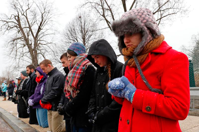 Pro-life advocates pray across from the Supreme Court building during the March for Life in Washington Jan. 22, the 43rd anniversary of the Supreme Court's Roe v. Wade decision legalizing abortion in the U.S.