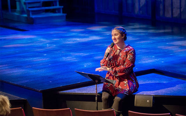 <p>Shannon Toot conducts the prologue to the Dec. 11 performance of &ldquo;A Christmas Carol&rdquo; at Geva Theatre in Rochester. (Courier photo by Jeff Witherow)  </p>