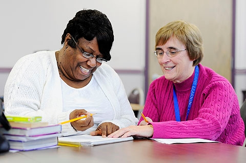 Barbara Wright (left) is tutored math by Sister Evelyn Breslin Jan. 17 at Notre Dame Learning Center in Rochester.