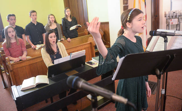 <p>Good Shepherd Catholic Community Junior Choir member Juliana Grantz sings during the 10:30 a.m. Mass at Our Lady of the Lake Church in King Ferry on April 7. (Courier photo by John Haeger) </p>