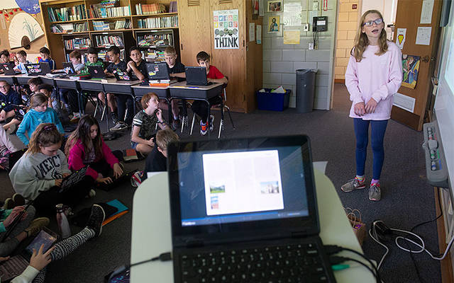 <p>Sophie Schenkel, a sixth-grader at Siena Catholic Academy in Brighton, presents her humanities project June 17 as her classmates take notes. (Courier photo by John Haeger)  </p>