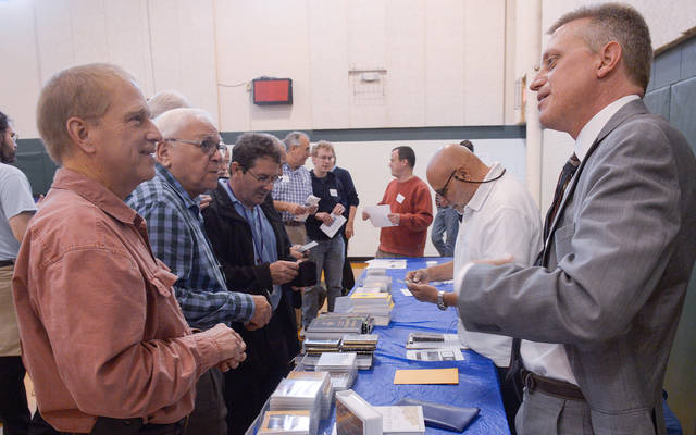 <p>Dr. John Bergsma speaks to Deacon Thomas Uschold of Spencerport during the 2018 Rochester Catholic Men&rsquo;s Conference. (File photo)   </p>
