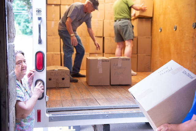 <p>Ann Marie Zon looks on Aug. 24 as boxes of donated items are packed into a truck at St. Patrick Church in Seneca Falls. The items will be distributed to the needy in Nicaragua. (Courier photo by John Haeger)  </p>