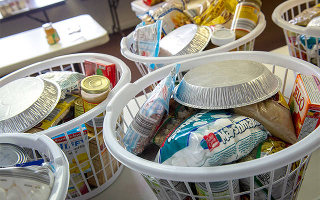 <p>Food items are prepared to be distributed through the food pantry at St. Jude the Apostle Church in Gates Dec. 21, 2016.  </p>