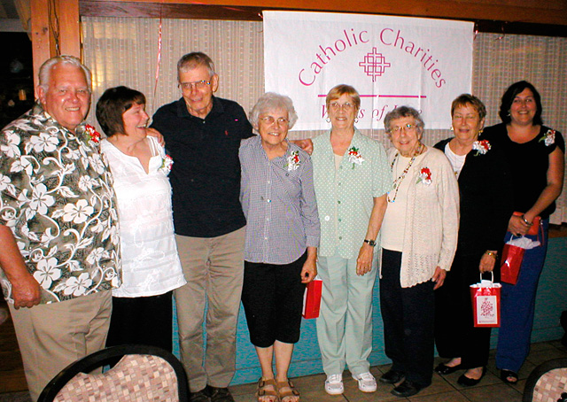 Jack Keefe (from left), Sharon Birdsall, Dick and Helen McGill, Dona Cincebox, Emilie Stuhlmiller, and Karen and Aimee Churchill recently were honored with Works of Love awards.