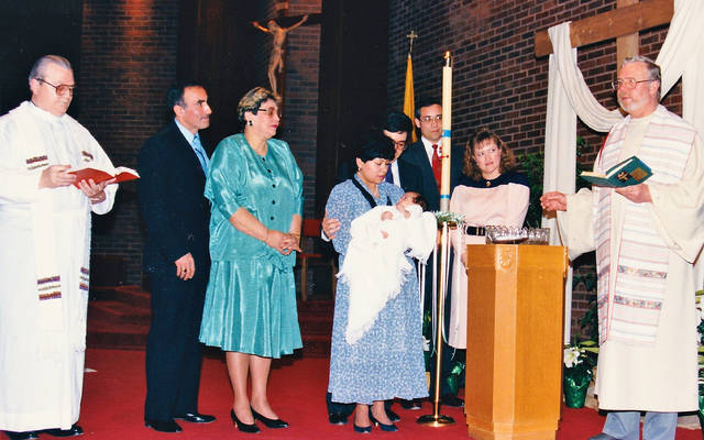 <p>Leonor and Ed Rivera (center) with Father John Murray (left), godparents Joe and Crimilda Rosario and Ismael and Maritza Campos, and Father Laurence Tracy at the baptism of their first son, Jordan. (Photo by Edwin S. Rivera)  </p>