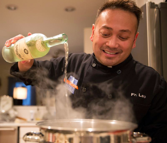 Celebrity chef Father Leo Patalinghug demonstrates how to cook a Lenten seafood pasta meal in his Baltimore kitchen Feb. 24.