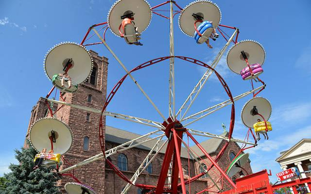 A carnival ride operates next to St. Mary Church in Canandaigua during the 2019 Summer Festival.