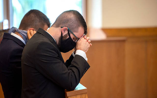 <p>Seminarian James Muscatella kneels during an Aug. 10 Mass for his Rite of Candidacy at the Diocese of Rochester&rsquo;s Pastoral Center in Gates. (Courier photo by Jeff Witherow)  </p>