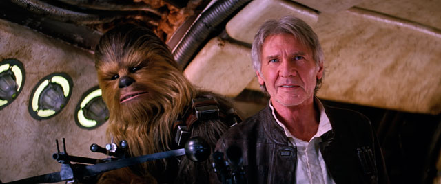 "Chewbacca, played by Peter Mayhew, and Harrison Ford star in a scene from the movie ""Star Wars: The Force Awakens."" The Catholic News Service classification is A-II -- adults and adolescents. The Motion Picture Association of America rating is PG-13 -- parents strongly cautioned. Some material may be inappropriate for children under 13."