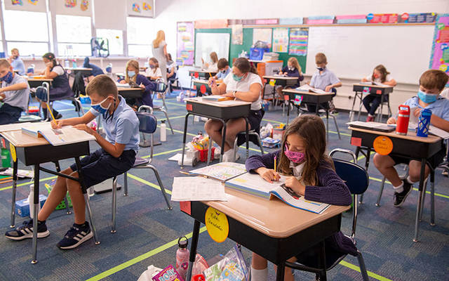 <p>Fifth-grade students at St. Pius Tenth School in Chili complete work in their classroom Sept. 18.  </p>
