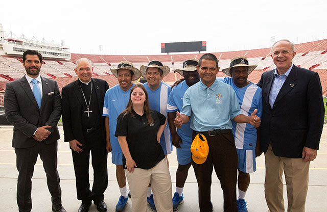 Los Angeles Archbishop Jose H. Gomez, second from left, and Supreme Knight Carl Anderson of the Knights of Columbus, far right, pose July 14 at the Los Angeles Memorial Coliseum with leaders and athletes of the 2015 Special Olympics World Games, scheduled next summer in Los Angeles. The Knights of Columbus has pledged $1.4 million to help cover costs for the games.