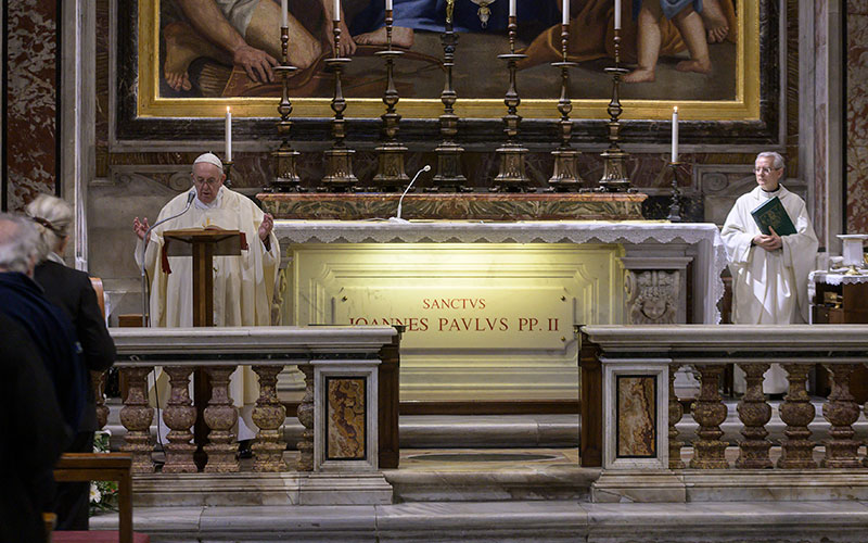 Pope Francis gives the homily at Mass at the tomb of St. John Paul II in St. Peter's Basilica May 18, 2020, the 100th anniversary of the late pope's birth.