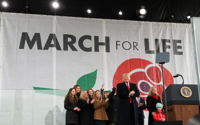 U.S. President Donald Trump applauds at march for life