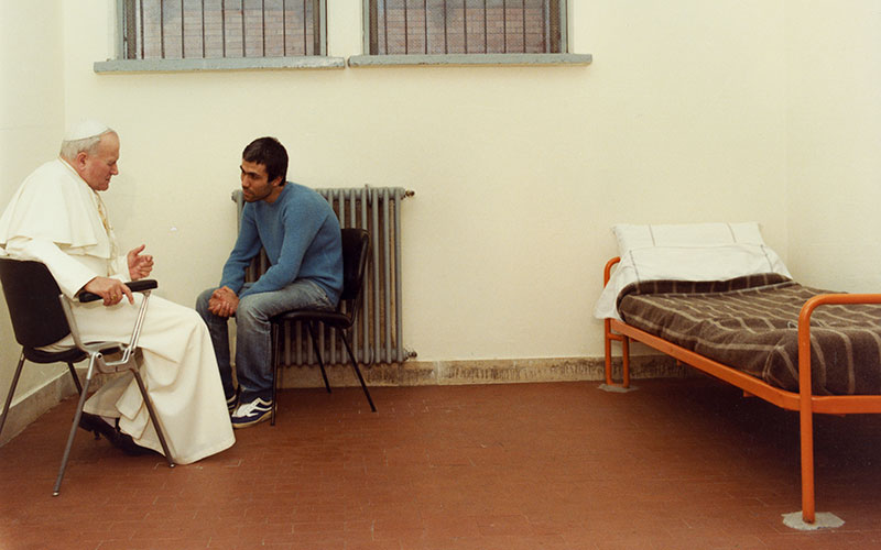 St. John Paul II sits with his would-be assassin, Mehmet Ali Agca, in Rome's Rebibbia Prison in 1983.