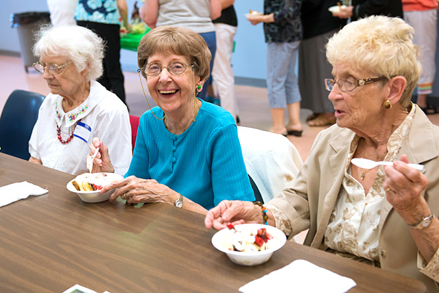Alberta VanGraafeiland (from left), Betty Pfeifer and Jean Meagher attend an ice cream social for members of the Circle of Hope ministry at Greece's St. John the Evangelist Parish June 17.