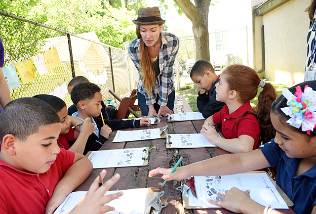 Lisa Barker from Seedfolk City Farm teaches School No. 28 second-graders about stewardship of the earth.