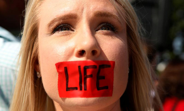 A pro-life supporter stands outside the U.S. Supreme Court June 27 during protests in Washington. In a 5-3 vote that day, the U.S. Supreme Court struck down restrictions on Texas abortion clinics that required them to comply with standards of ambulatory surgical centers and required their doctors to have admitting privileges at local hospitals.