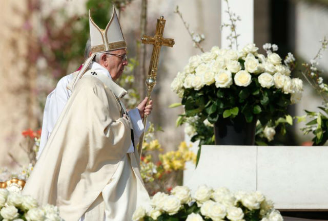 Pope Francis arrives to celebrate Easter Mass in St. Peter's Square at the Vatican March 27.
