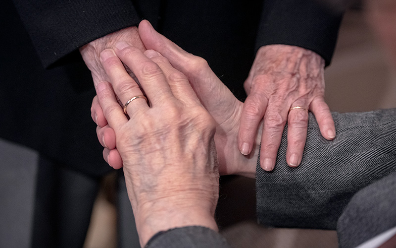 A couple holds hands during the Marriage Recognition Mass at Rochester's Sacred Heart Cathedral May 19, 2019.