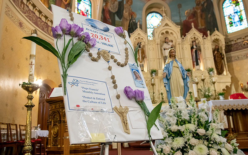 A board tracking St. Stanislaus Kostka Parish's rosary recitations is seen at the church in Rochester.