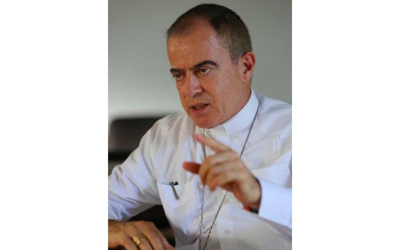 Archbishop Roberto Gonzalez Nieves gestures