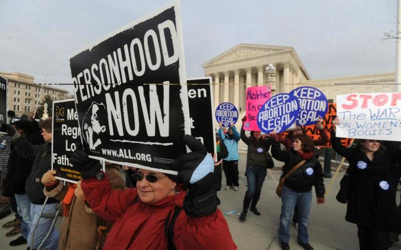 A pro-lifer from Louisiana holds a sign in front of the U.S. Supreme Court building