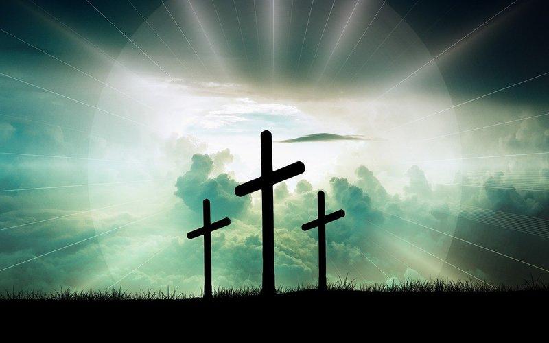 three crosses in sunlight