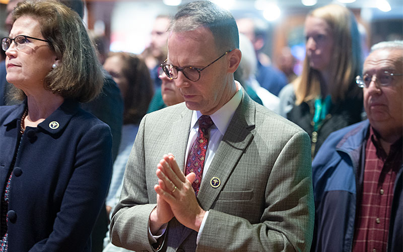 Dr. Elissa Sanchez-Speach and Dr. David Speech, members of the Finger Lakes Guild of the Catholic Medical Association, pray Oct. 26 during the White Mass at St. Louis Church in Pittsford. (Courier photo by John Haeger)