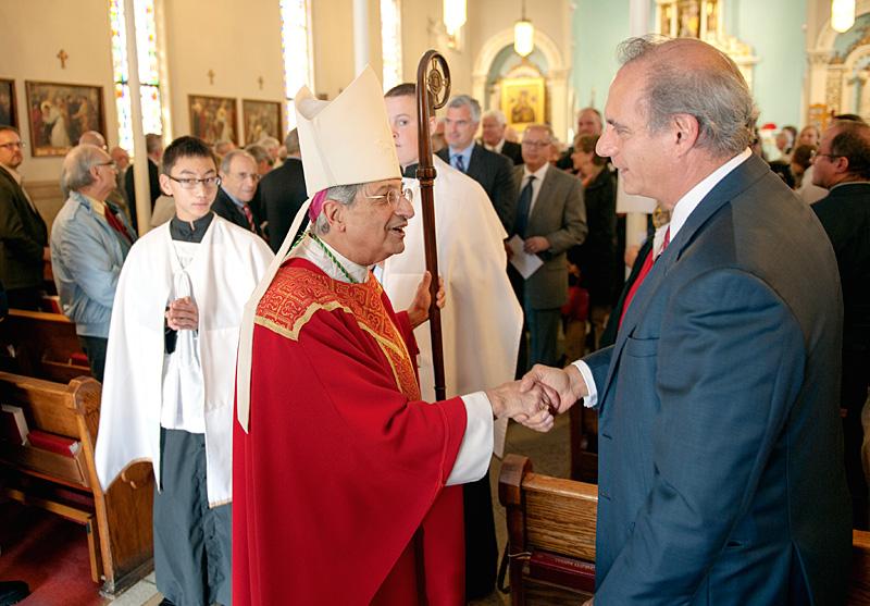 Bishop Salvatore R. Matano greets parishioner after Red Mass.