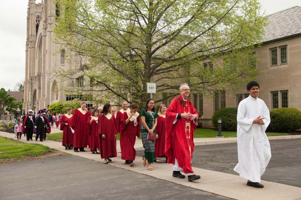 Father Kevin McKenna (second from right in red), rector of Sacred Heart Cathedral, begins the procession.