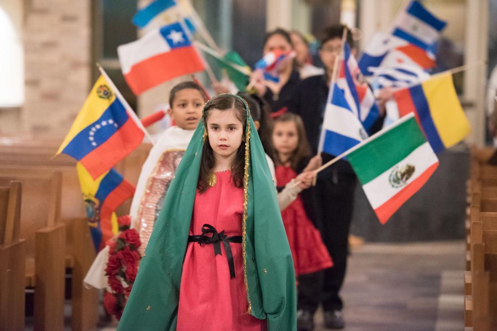 Marieva Page leads a flag procession.